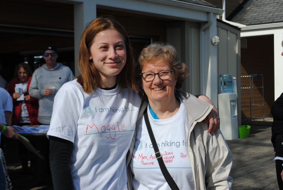 Two women with Hike for Hospice t-shirts on